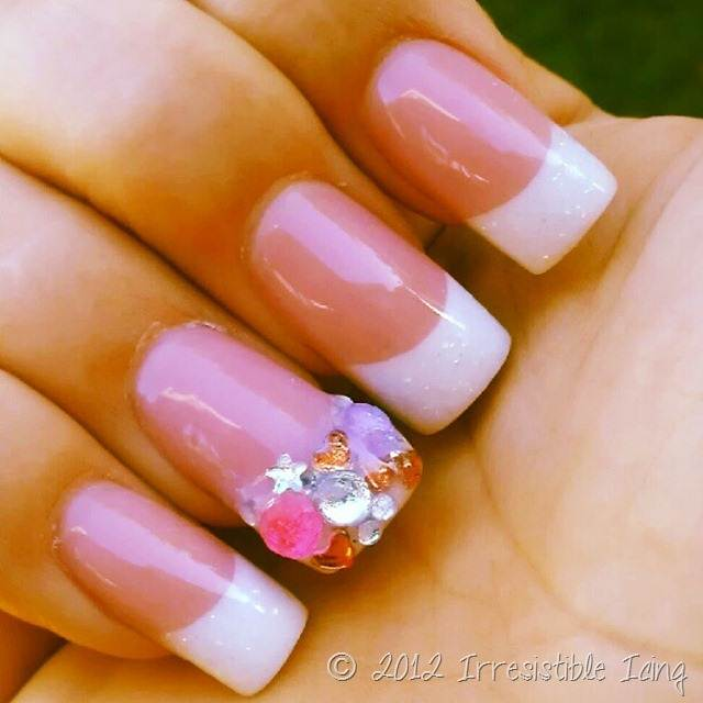 pink and white nails with rhinestones